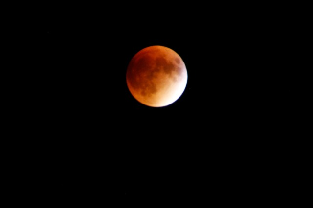 Last Sunday, a rare astronomical alignment took place. Before the clouds rolled in, the super blood moon was visible from campus. This lunar eclipse is rare because it's one of the few occurrences when a super moon and a lunar eclipse coincide with each other.  A super moon refers to when the moon is at its closest distance to Earth. A lunar eclipse occurs when the moon passes behind Earth's shadow. The reddish color of the lunar eclipse is caused by light being scattered through Earth's atmosphere and reflecting only red light back onto the moon. When these two lunar phenomena take place at the same time, the result is a super blood moon. Super blood moons, or supermoon eclipses, are very rare. The next time we will be able to see the next one will be in 2033. This lunar eclipse was also the last of the lunar tetrad, a series of four consecutive lunar eclipses in a two year period. Photo by Michael Feist.