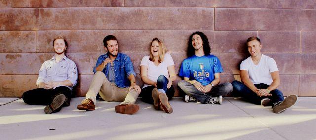 A photo of the five bandmates taken by Theresa Kolar.